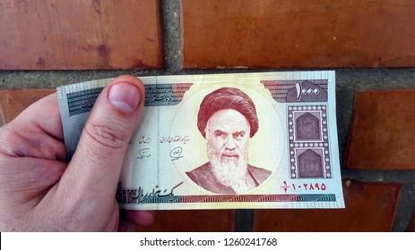 Money of Iran. Iranian bill. Iranian rials bank note in male hand
