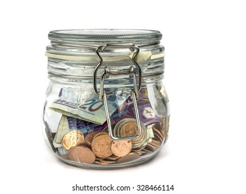 Money in jar : Concept for saving , Isolated on white background