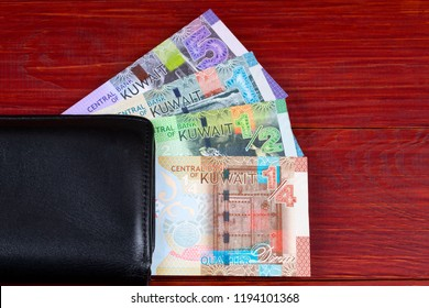 Money from Kuwait in the black wallet
