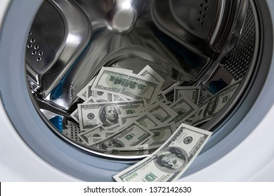 Money laundering concept. AML. Money in washing machine
