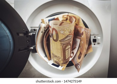 money laundering concept. euro banknotes out of washing machine