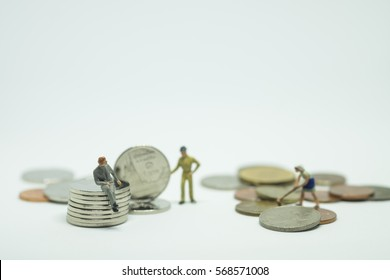 Money laundering concept, miniature people cleaning up dirty coins