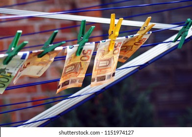 Money laundering euro notes on a leash