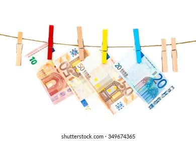 Money laundering on clothesline isolated on white background.  Euro banknotes hanging