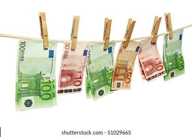 Money laundering on clothesline isolated on white background