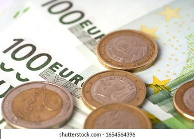 Money laundering on clothesline on light background. 100 eur notes.