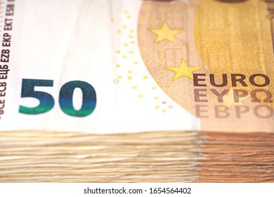 Money laundering on clothesline on light background. 50 eur notes. 50 eur banknotes - Shutterstock ID 1654564402