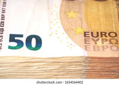 Money laundering on clothesline on light background. 50 eur notes. 50 eur banknotes