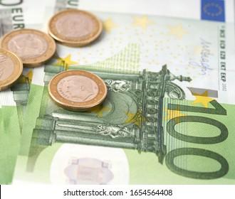 Money laundering on clothesline on light background. 100 eur notes. 100 eur banknotes.