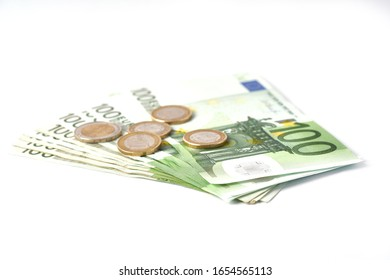 Money laundering on clothesline on light background. 100 eur notes. Banknotes and coins at white background