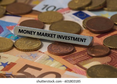 money market investment - the word was printed on a metal bar. the metal bar was placed on several banknotes