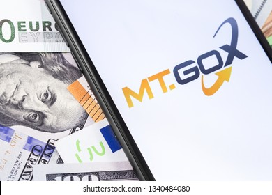 money and MT.GOX logo of exchange on the screen smartphone. MT.GOX is popular largest cryptocurrency exchange on the market. Moscow, Russia - February 13, 2019