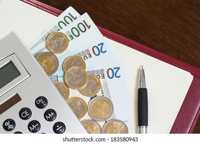 Money, notepad and calculator on the table
