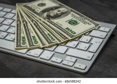 A lot of money on a computer keyboard