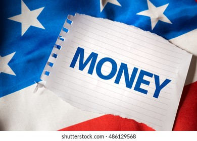 Money on notepaper and the US flag