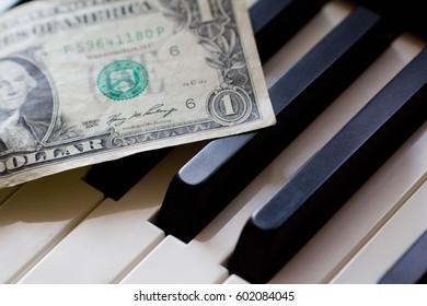 Money on Piano Keys