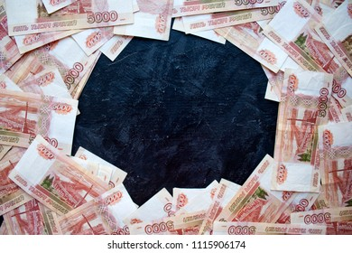 Money on Russia on black background. Close-up of Russian rubles on five thousand banknotes with copy space. Finance concept.