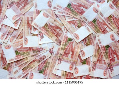 Money on Russia on black background. Close-up of Russian rubles on five thousand banknotes. Finance concept.