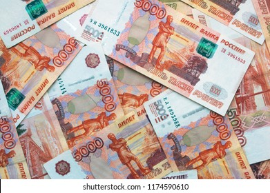 Money on Russia. Close-up of Russian rubles on five thousand banknotes. Finance concept.