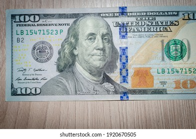 Money on the table (one hundred dollar bill).