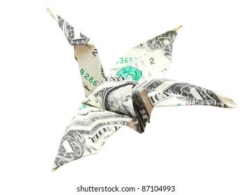 A money origami bird in business