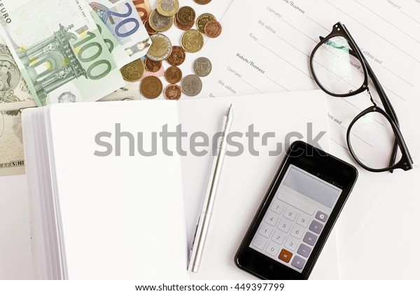 money phone calculator pen paper and glasses on white background,  financial analytics concept, calculating budget, currency balance
