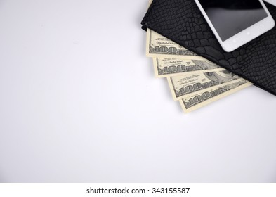 money and phone  in wallet on white background