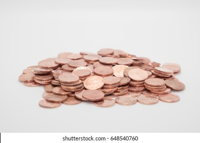 money pile of bath dirty coin copper on white background finance business isolated