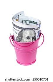 Money in a pink bucket, isolated over white background.