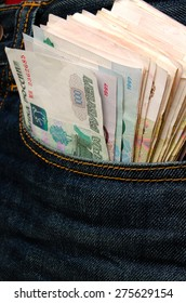 Money in the pocket of blue jeans.
