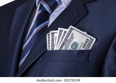 Money in the pocket of business suit