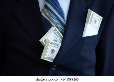 money in the pocket of a businessman
