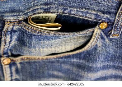 Money in a pocket of old jeans