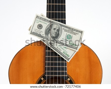Money Put Between The Chords Of A Cl Ical Guitar