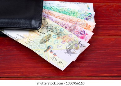 Money from Qatar in the black wallet
