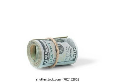 Money.  Roll of dollars isolated on white