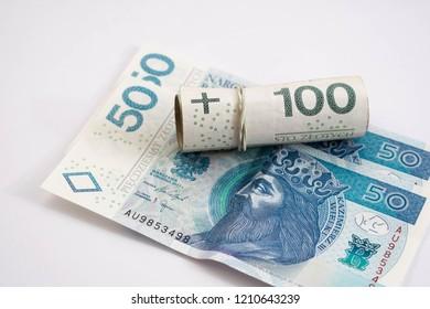 Money roll made with Polish Zloty banknotes (PLN). Polish One Hundred Zlotych