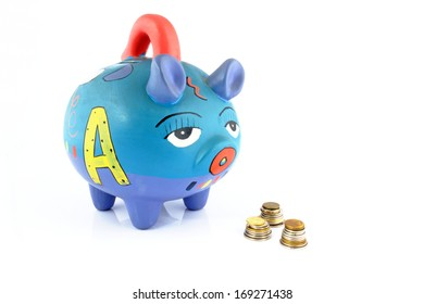 Money saving in a colorful piggy bank isolated on white background