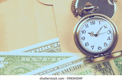 Money saving concept with vintage clock for the past.