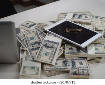 money saving concept.Businessman with cash dollars - business concept tablet and finance.