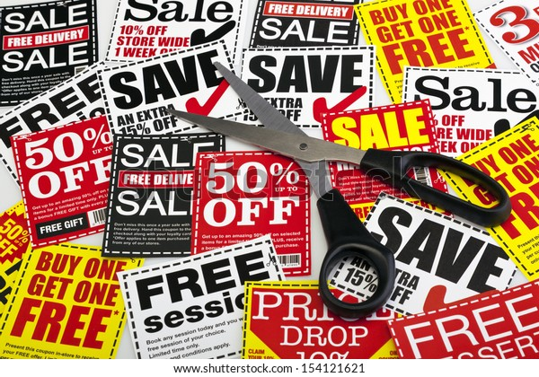 Money saving coupon vouchers with scissors. No dollar, euro or pound signs. Coupons created by photographer.