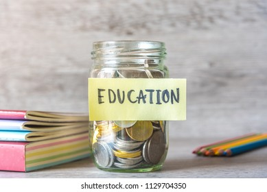 Money Saving For Education In The Glass Bottle For Money Financial Concept.