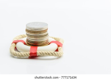Money saving and financial wealth protection concept : Stack of coins in a red lifebuoy on white background. Securing large value of money by applying an insurance, insured assets safe & secure future