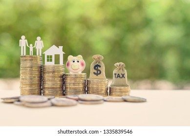 Money saving, first time asset / property buyer concept : Family couple, home model, piggy bank, dollar and tax bags on stacks of rising coins, depict budget planning for basic needs, personal expense