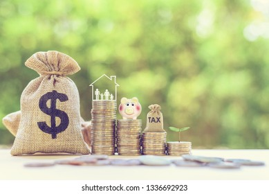 Money saving, first time asset / property investment concept : Family couple, baby kids in home, piggy bank, dollar & tax bags on rising coins, depict budget planning for basic needs, personal expense
