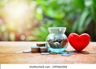 money saving set with red heart for concept donation and philanthropy