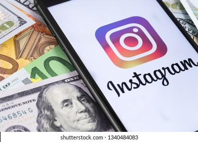 money and smartphone displaying the Instagram logo. Social media. Instagram is a photo-sharing app for smartphones. Moscow, Russia - March 12, 2019