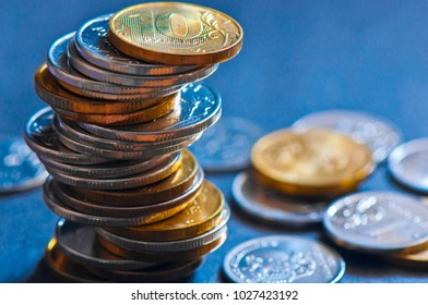 Money. Stack of russian rubles coins, blue background