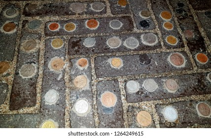 Money in the street. The coins are liying on the pavement