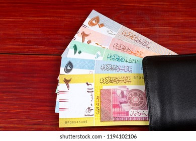 Money from Sudan in the black wallet
